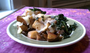 fried potatoes with cheese and kale